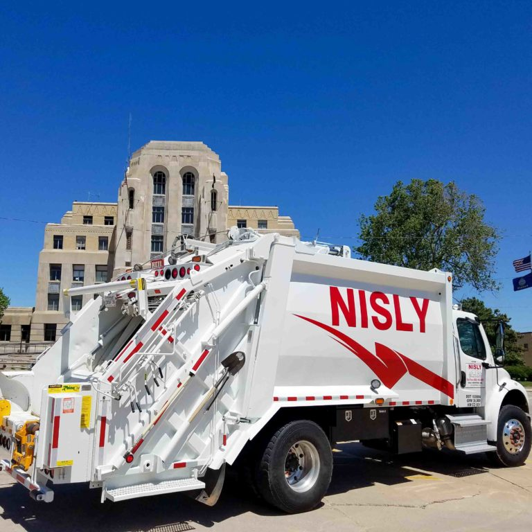 nisly brothers waste management service truck in city